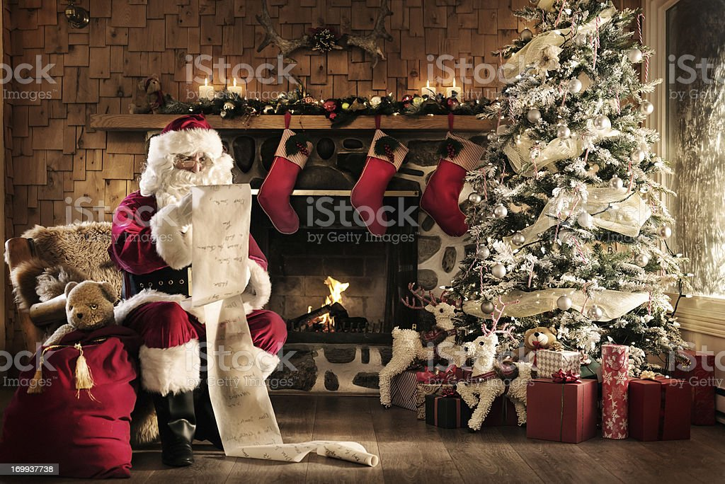 Santa reading the list stock photo