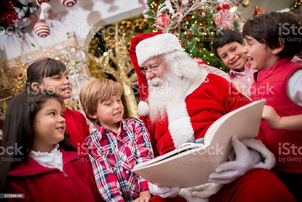 Santa reading to the children stock photo