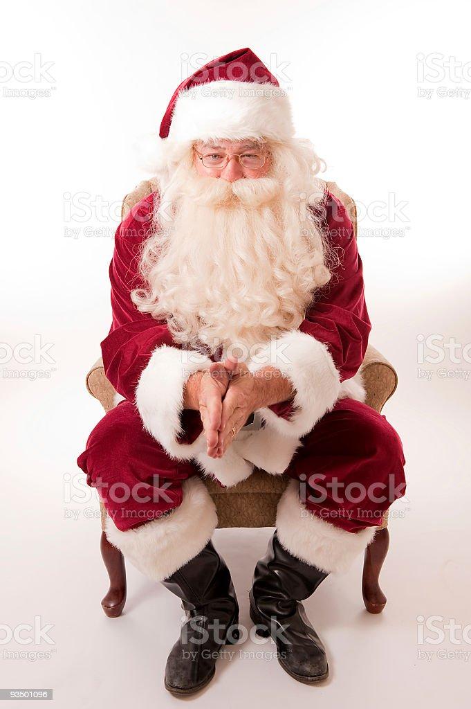 Santa rubbing his hands stock photo