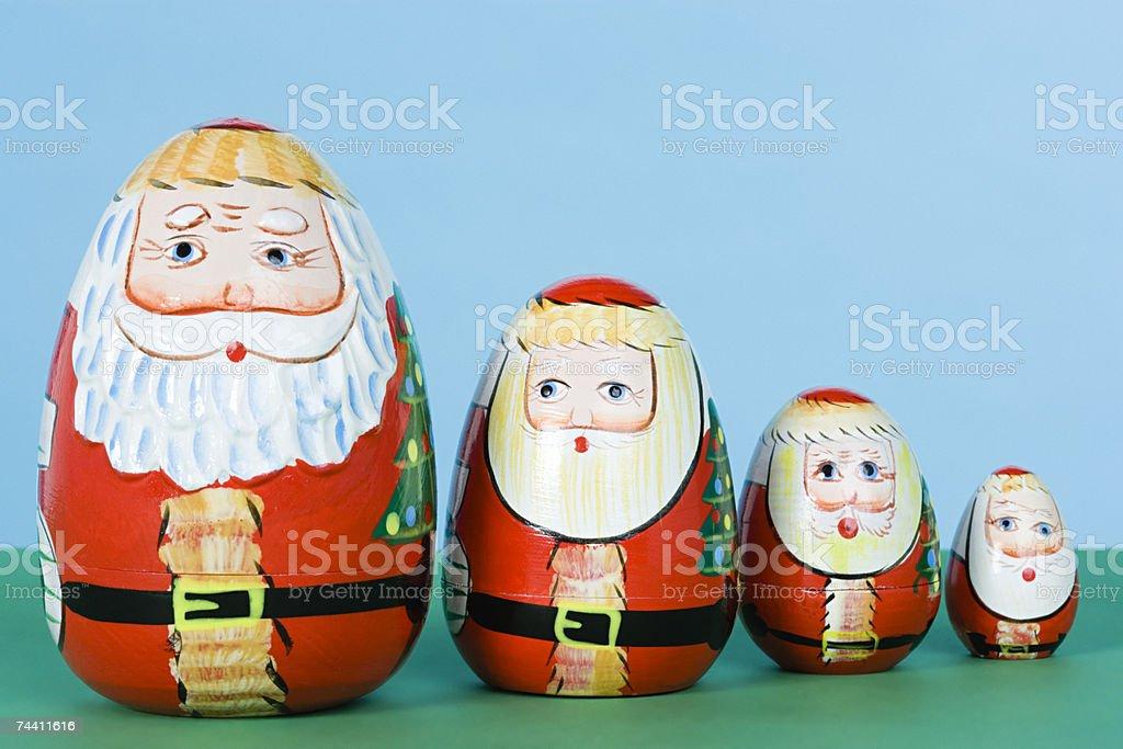 Santa russian dolls in a row royalty-free stock photo