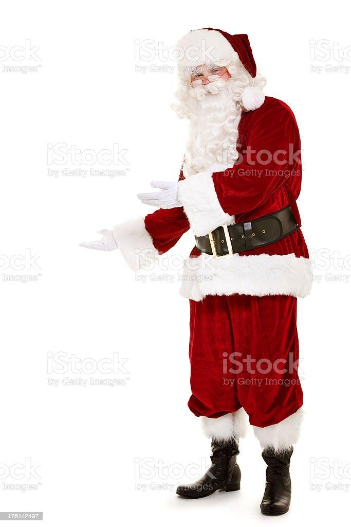 Santa showing anything isolated on white royalty-free stock photo