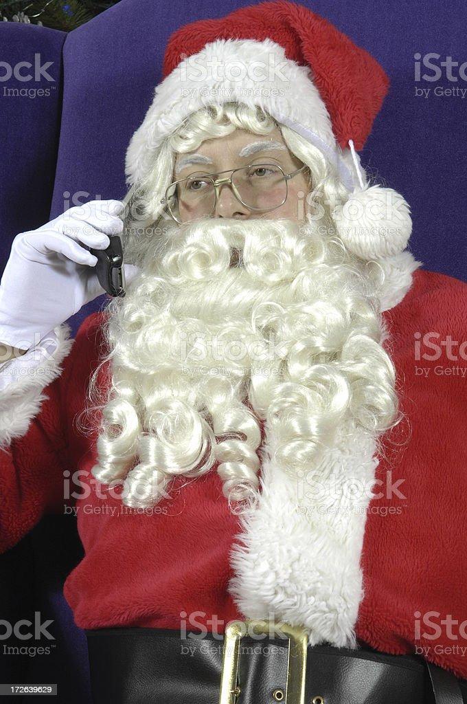 Santa Takes A Call stock photo
