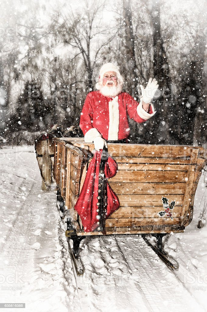 Santa Waving From The Back of A Horse Drawn Sleigh stock photo