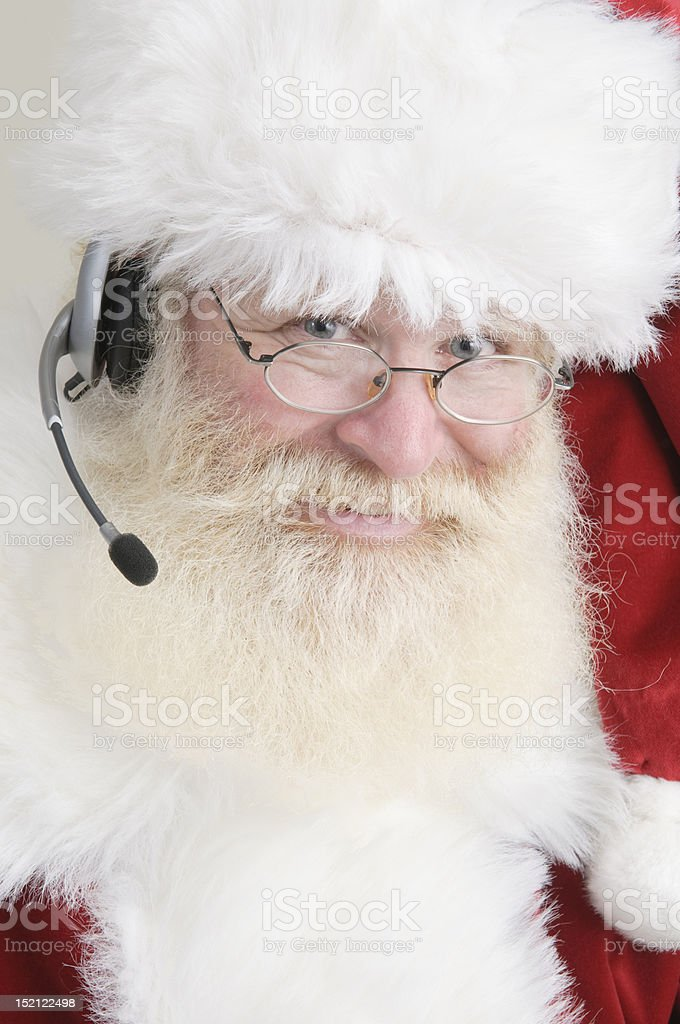 Santa wearing a headset royalty-free stock photo