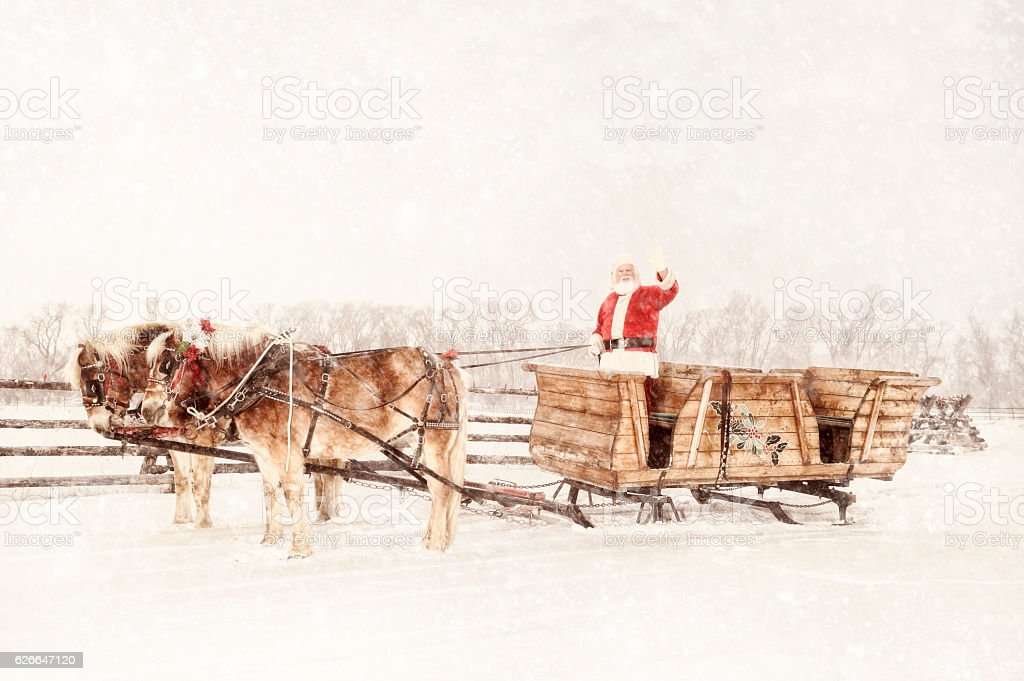 Santa With A Sled and Team of Horses Christmas Day stock photo