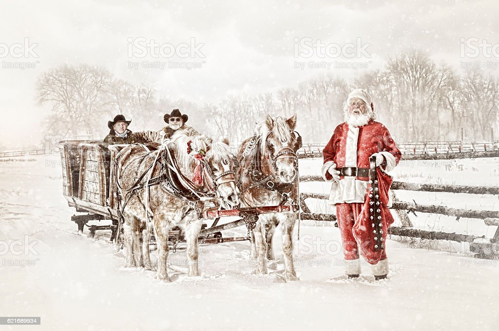 Santa With a Team of Horses Sled and Two Cowboys stock photo