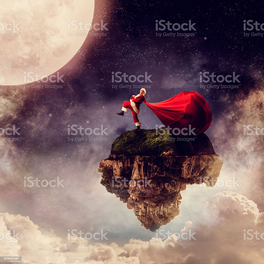 Santa with a very big bag of gifts stock photo