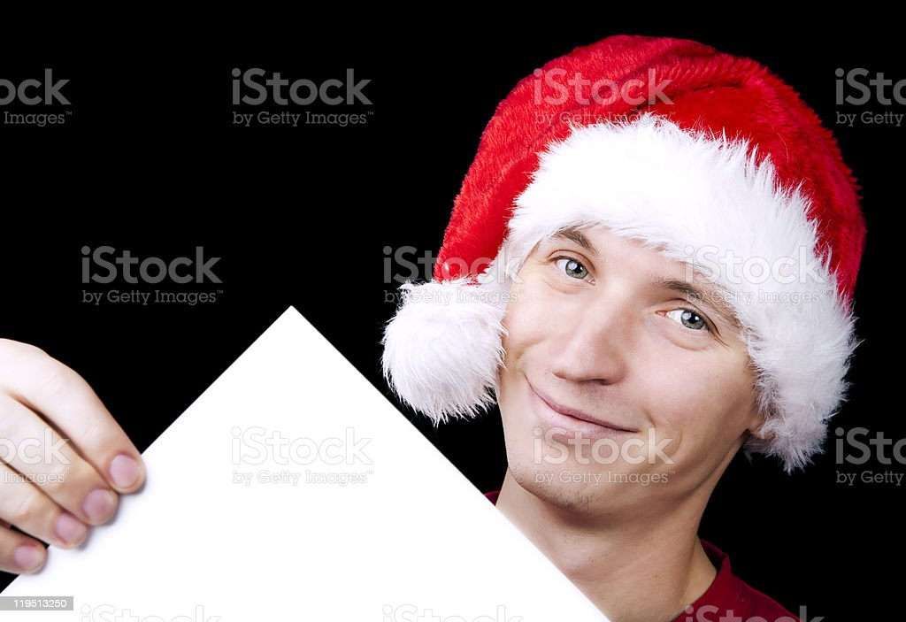 Santa with blank sheet of paper stock photo