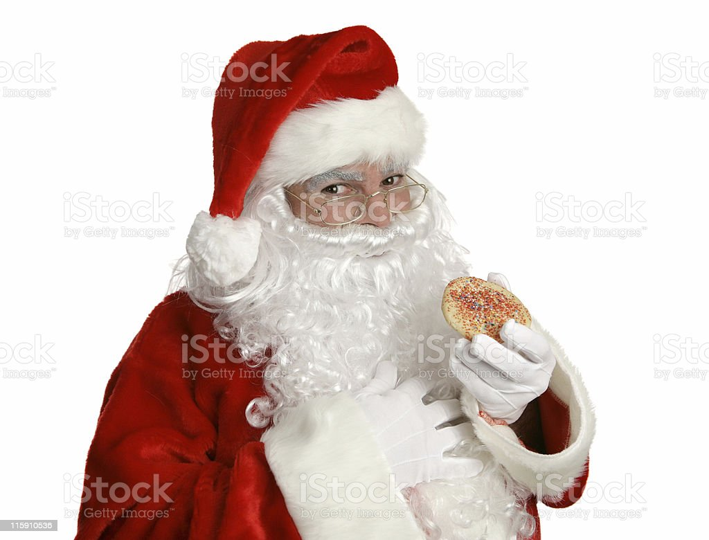 Santa With Christmas Cookie royalty-free stock photo
