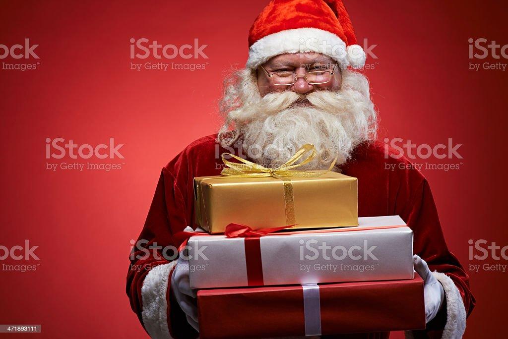 Santa with Christmas presents royalty-free stock photo