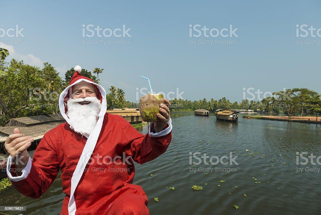 Santa with coconut stock photo