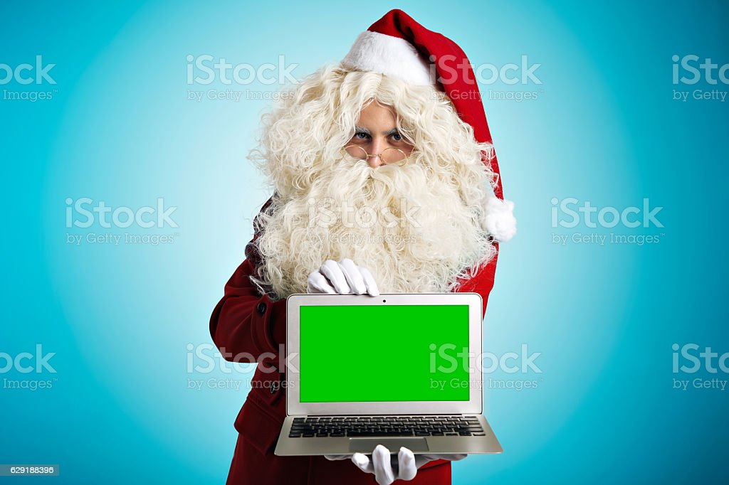 Santa with gadgets in hands stock photo
