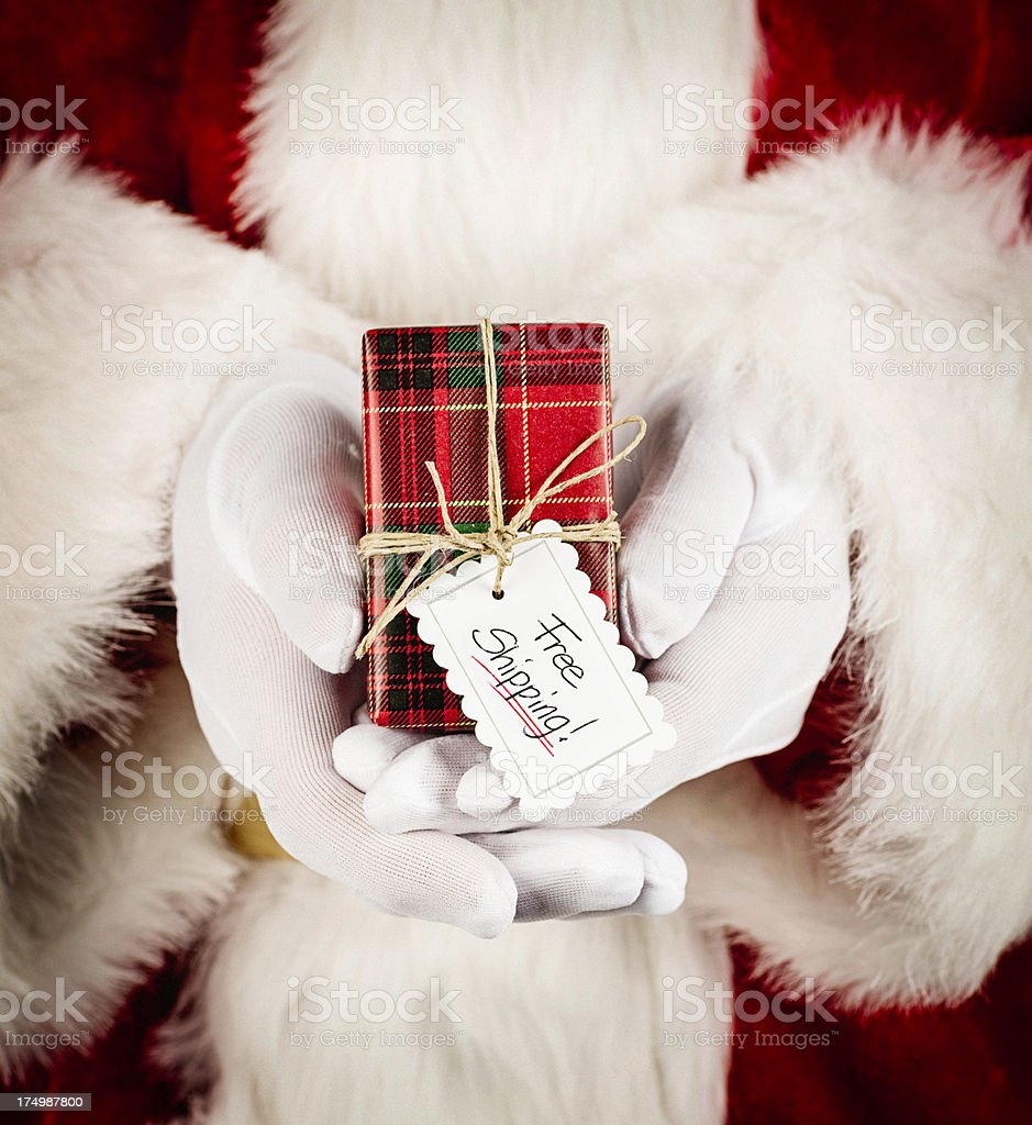 Santa with Gift: Free Shipping royalty-free stock photo