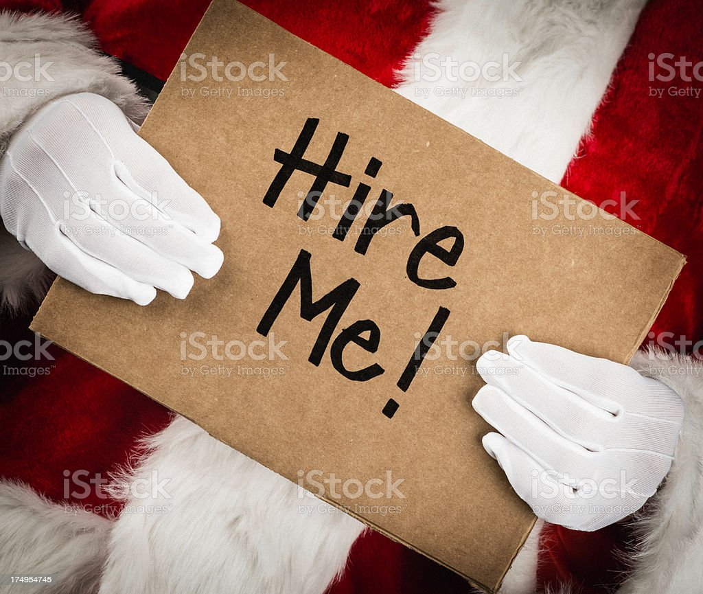 Santa with Hire Me Sign stock photo