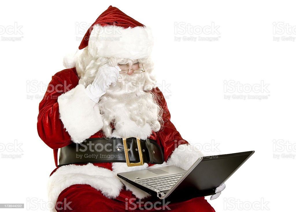 Santa with laptop isolated on white royalty-free stock photo