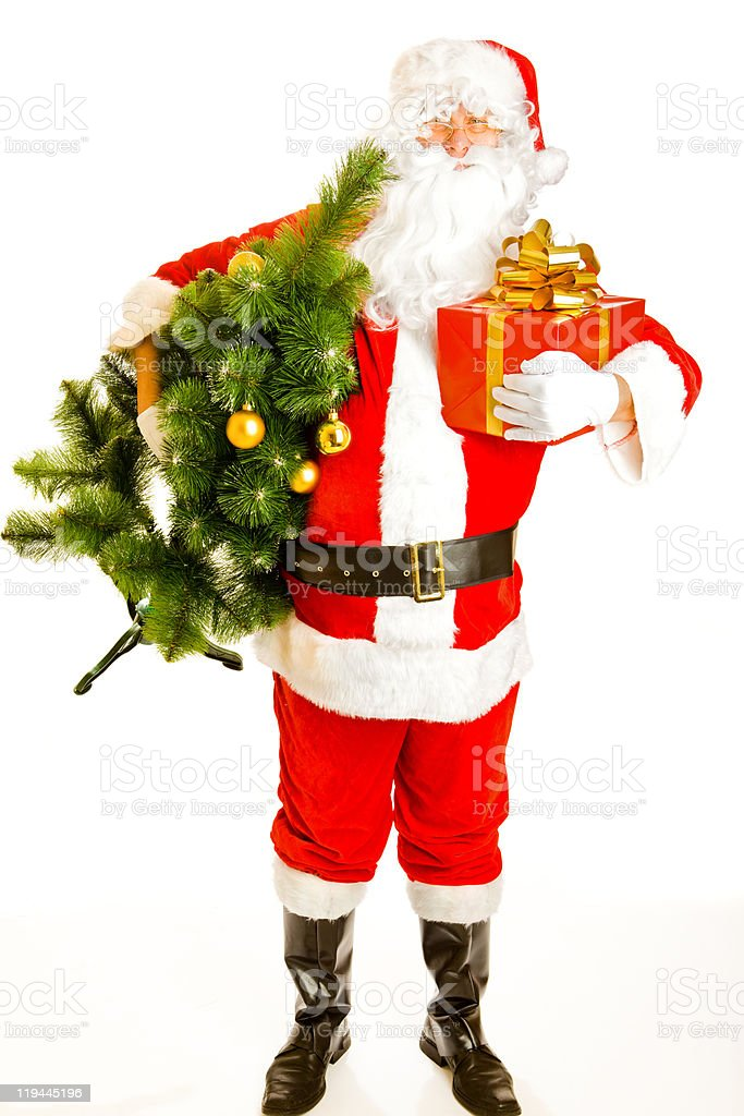 Santa with present and christmas tree royalty-free stock photo