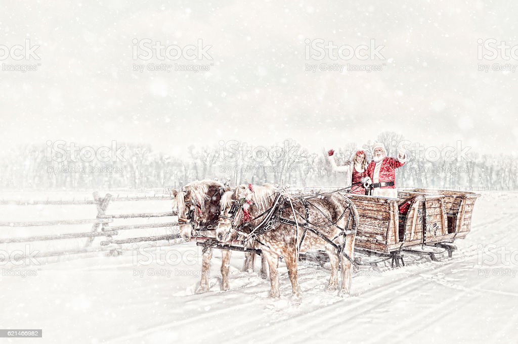 Santa With Sleigh - Horses and Helper stock photo