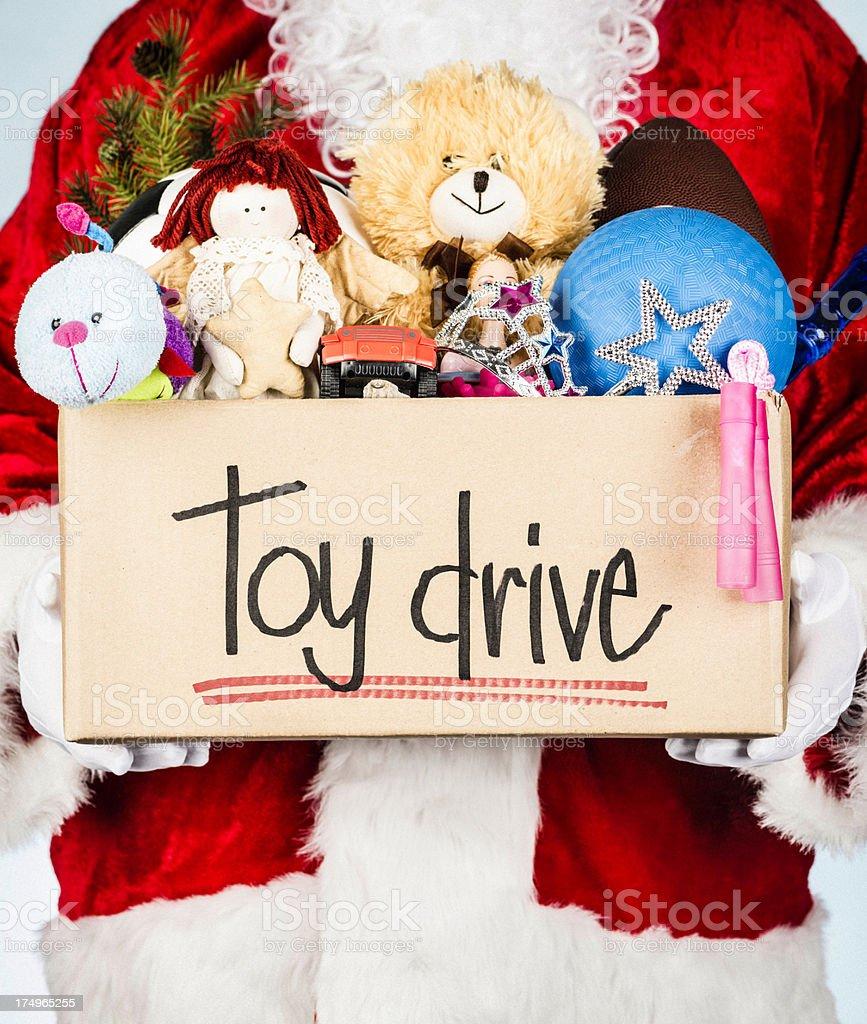 Santa with Toy Drive Donation Box stock photo