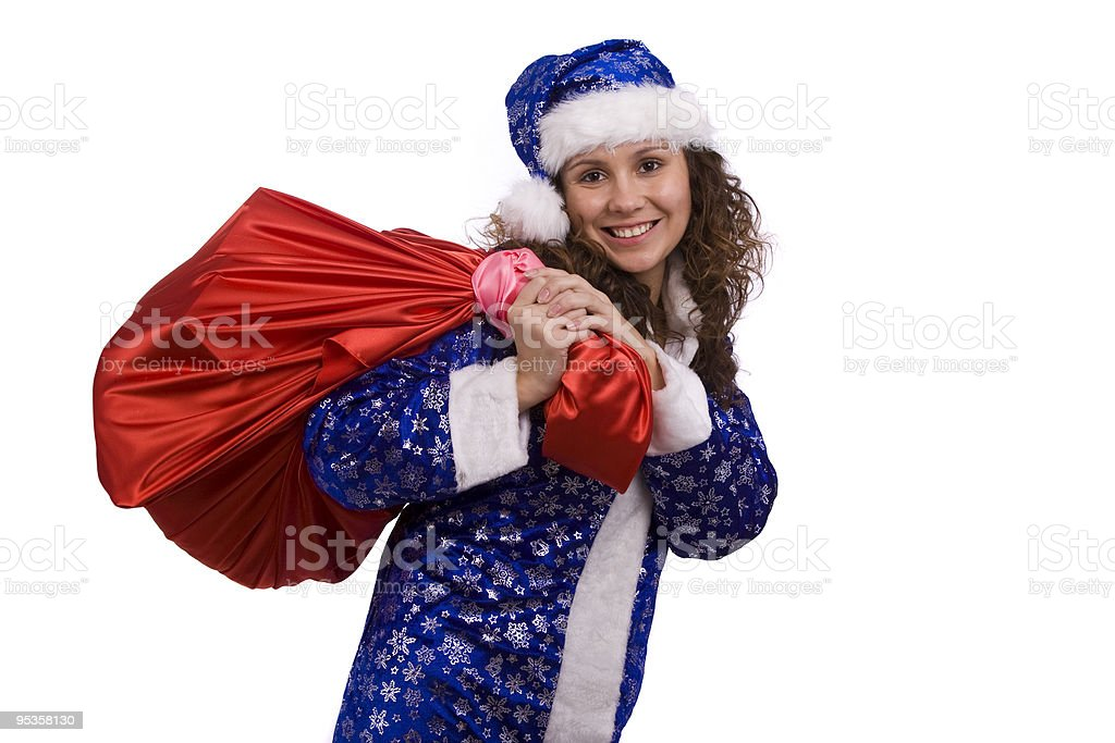 Santa woman is holding red sack with gifts royalty-free stock photo
