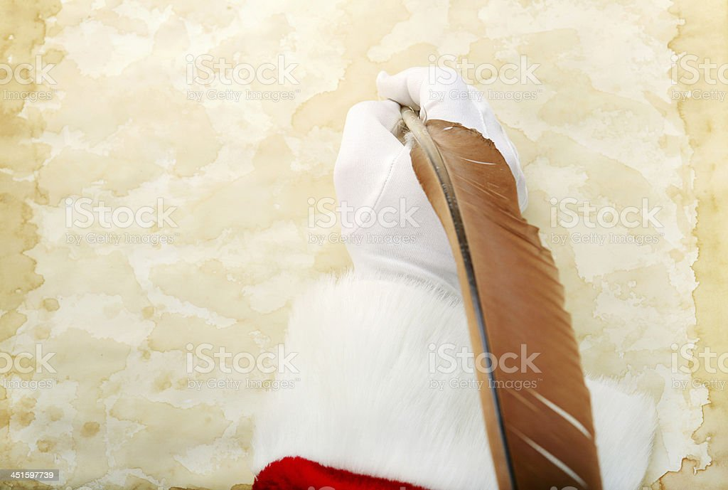 Santa Writes on Parchment stock photo
