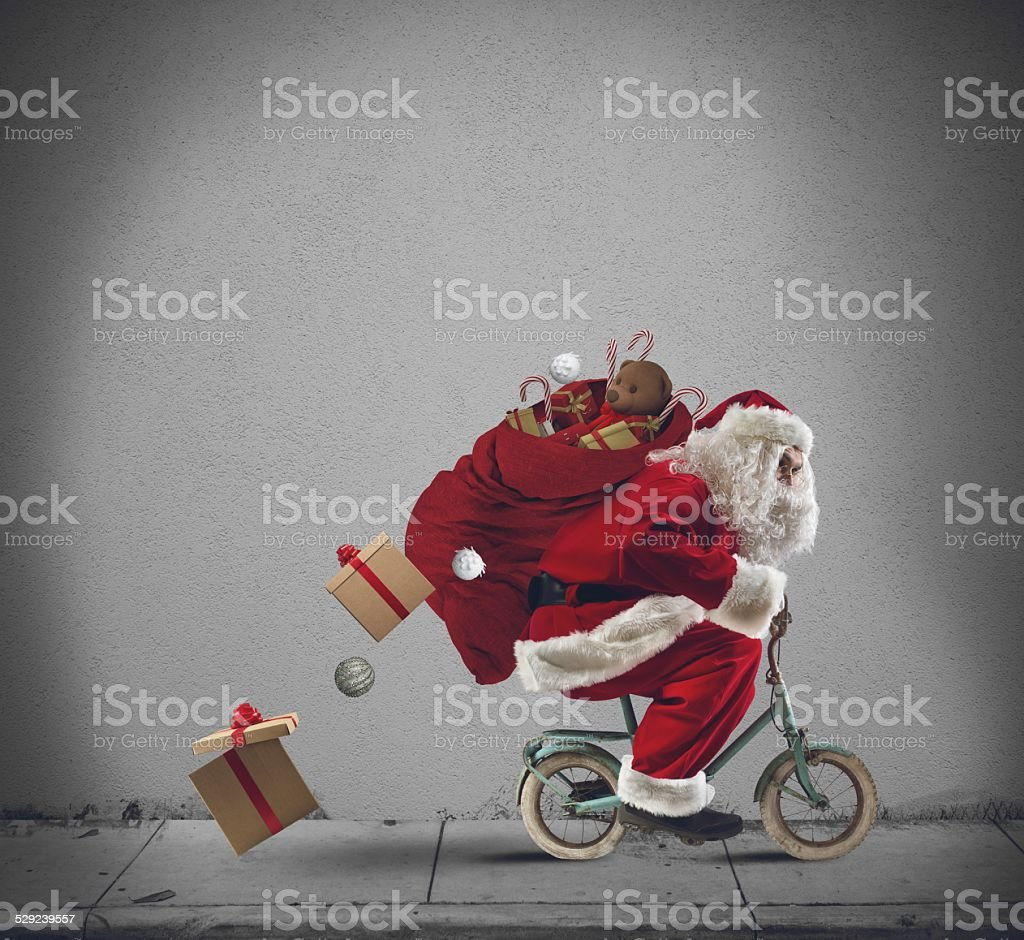 Santaclaus on the bicycle stock photo