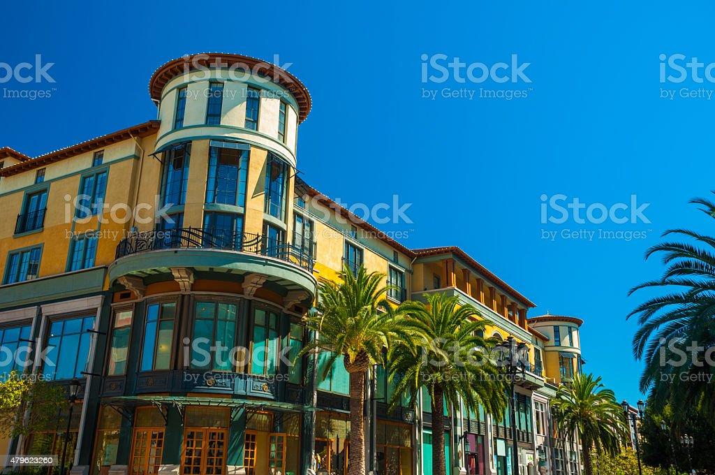 Santana Row building with palm trees in San Jose, CA stock photo
