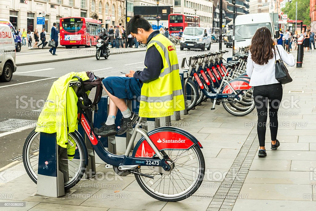 Santander rental bikes employee is sitting on a bike stock photo
