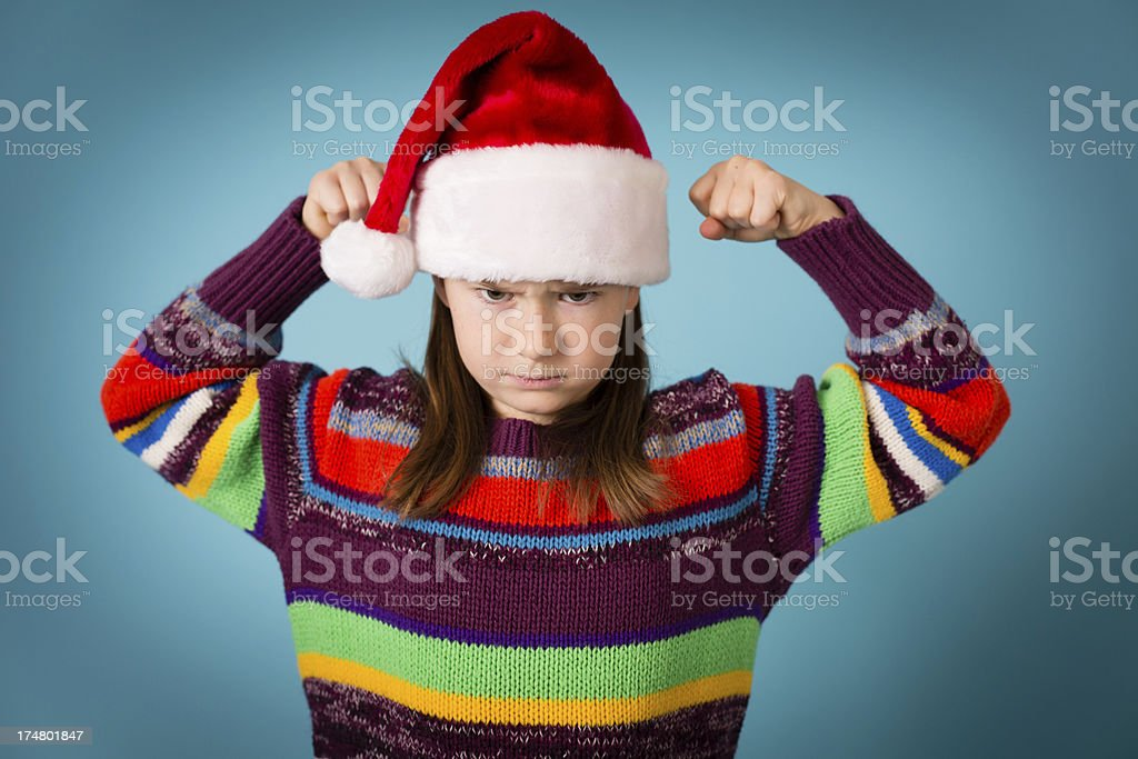 Santa's Angry Little Helper Wearing Hat and Ugly Sweater royalty-free stock photo