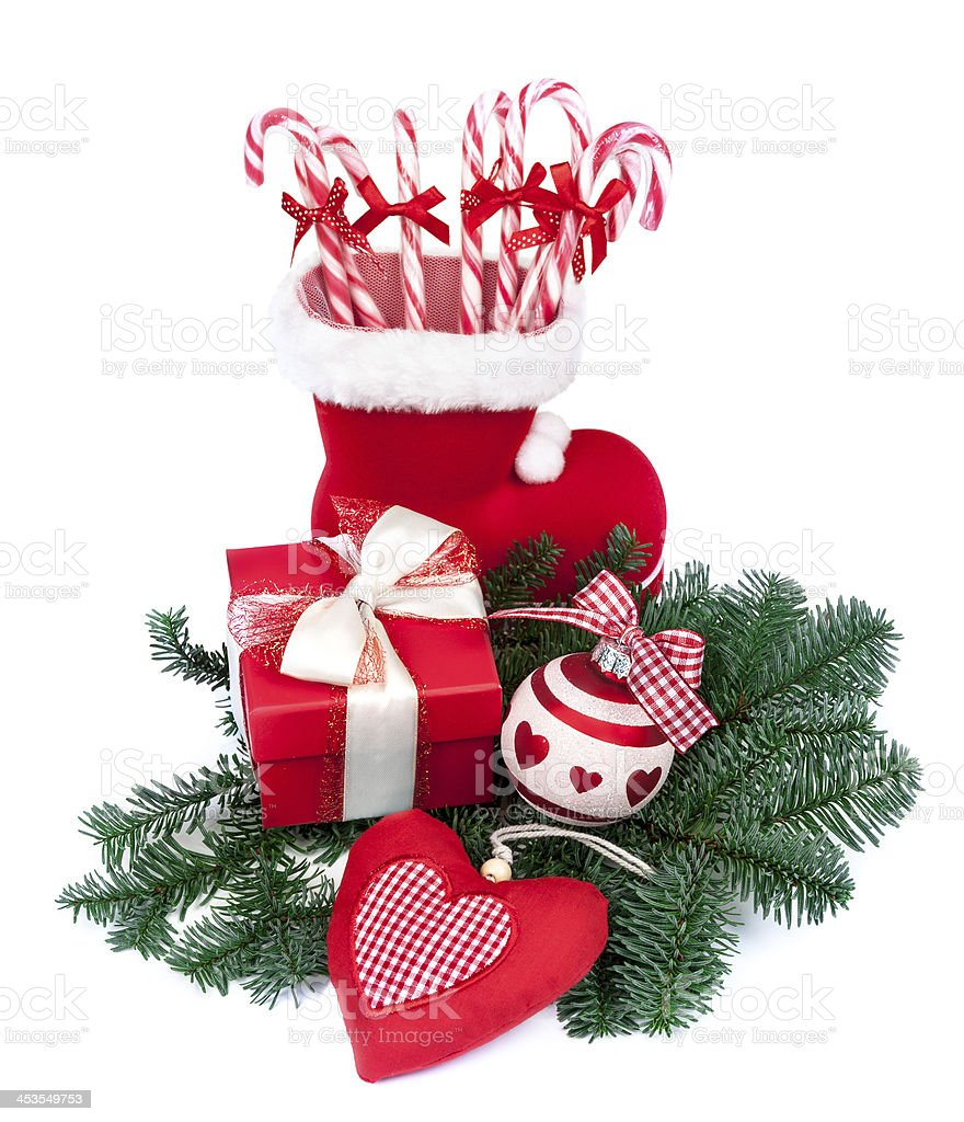 Santa's boot with candy sticks royalty-free stock photo