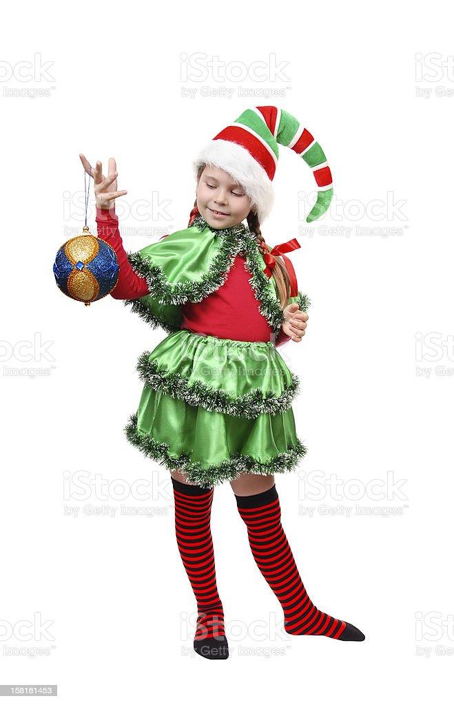 Santa's elf with a Christmas ball. royalty-free stock photo