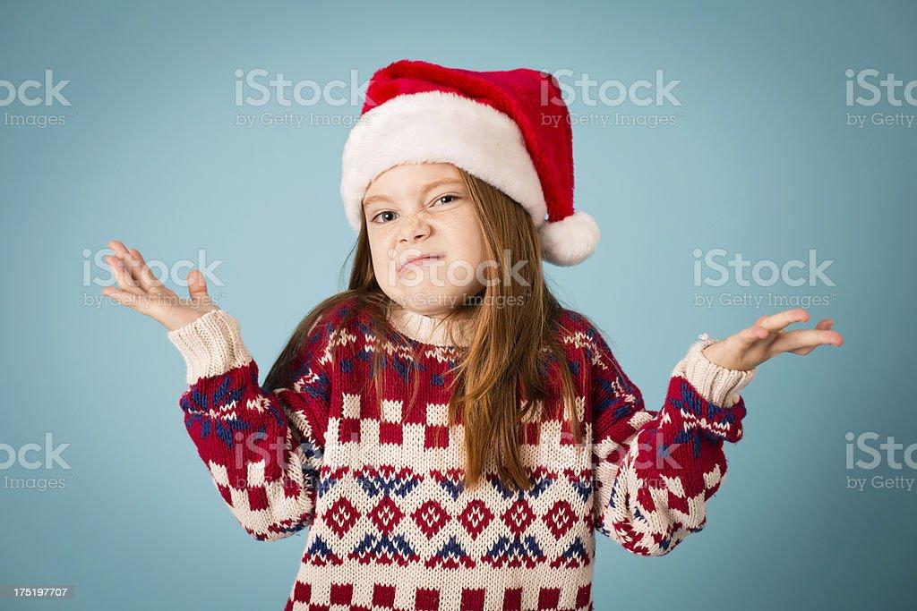 Santa's Grumpy Little Helper Throwing Her Hands in Air royalty-free stock photo