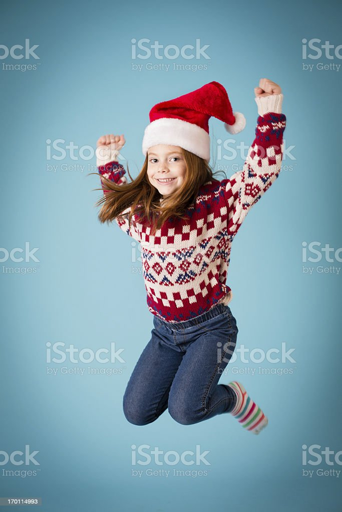 Santa's Happy Little Helper Jumping for Joy royalty-free stock photo
