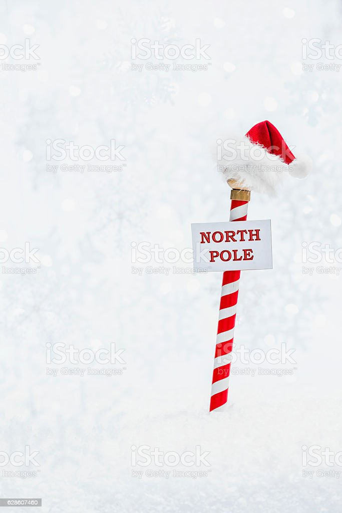 Santa's hat atop the red and white North pole stock photo