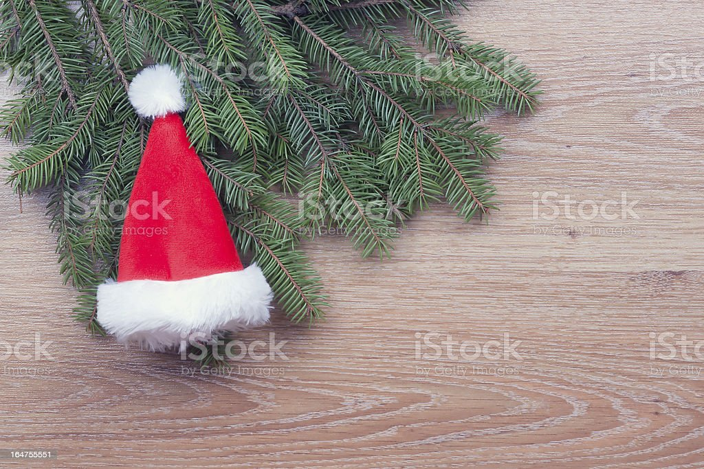 Santa's hat hanging on fir branches royalty-free stock photo