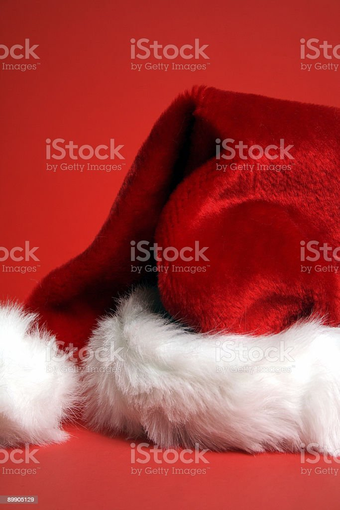 Santa's Hat on red Background royalty-free stock photo