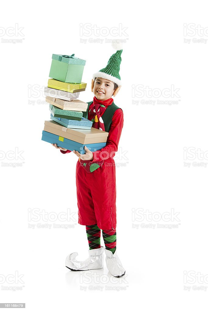Santas Helper Elf Carries a Tall Stack of Christmas Presents royalty-free stock photo
