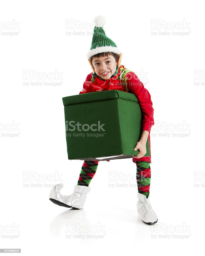 Santas Helper Elf Struggles with Big Heavy Christmas present. royalty-free stock photo