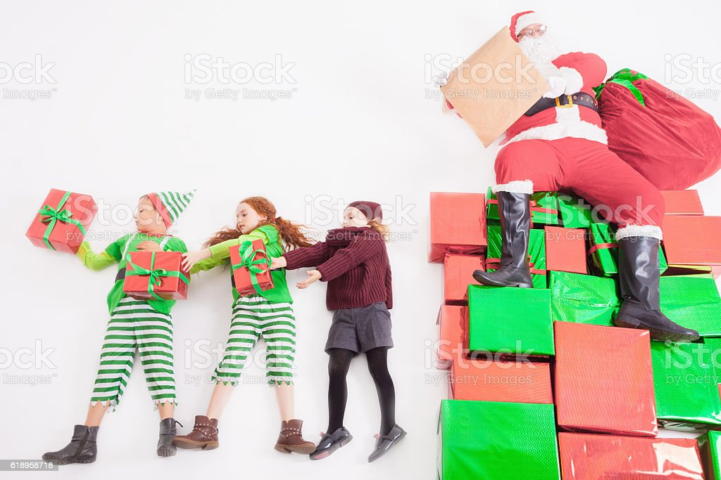 Santa's helpers working at North Pole. He Reading wishes stock photo