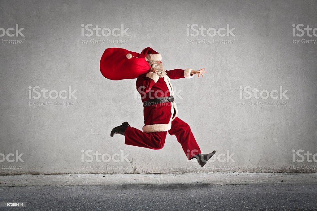 Santa's in a rush stock photo