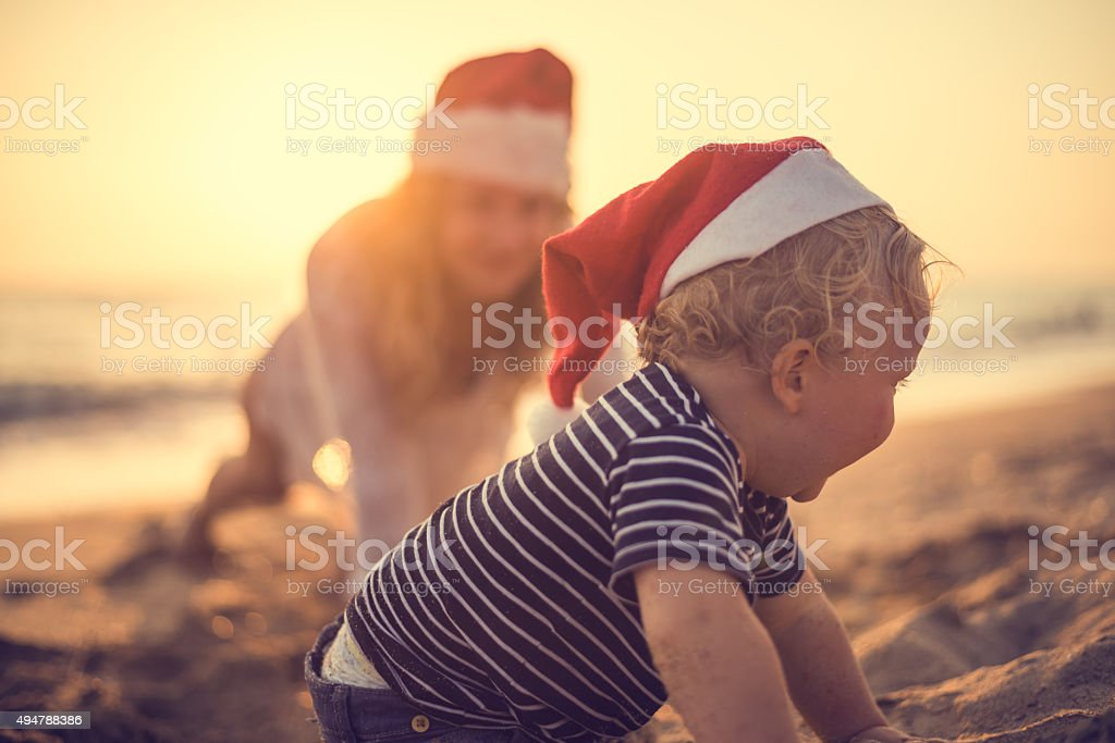 Santa's little helper at the beach stock photo
