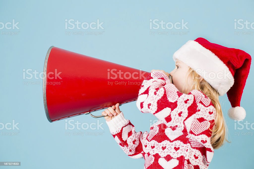 Santa's Little Helper Making Announcement With Megaphone royalty-free stock photo