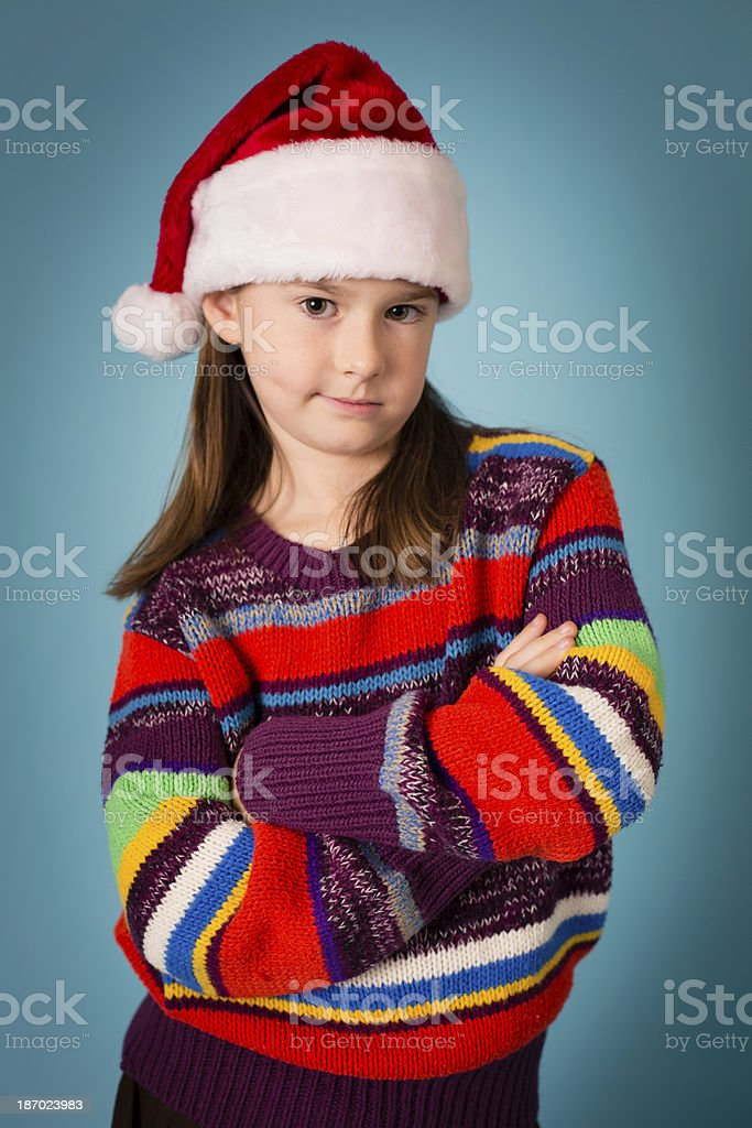 Santa's Skeptical/Disgusted Little Helper Wearing Hat royalty-free stock photo