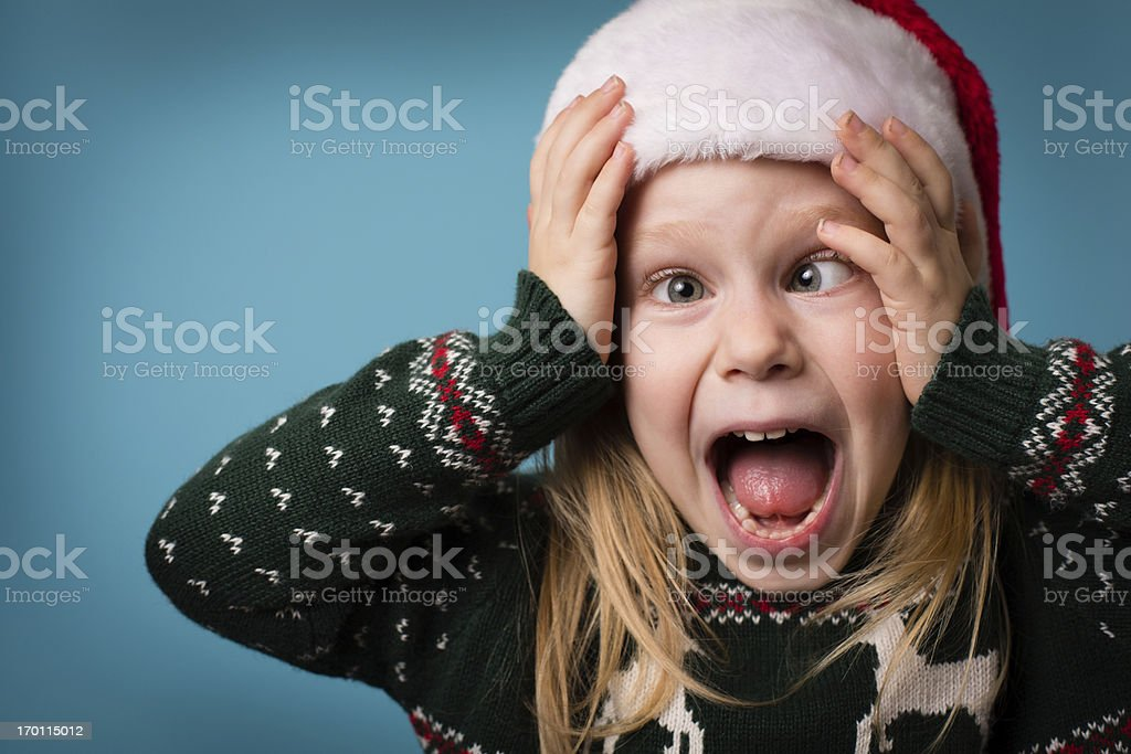 Santa's Stressed Little Helper Wearing Hat and Christmas Sweater royalty-free stock photo