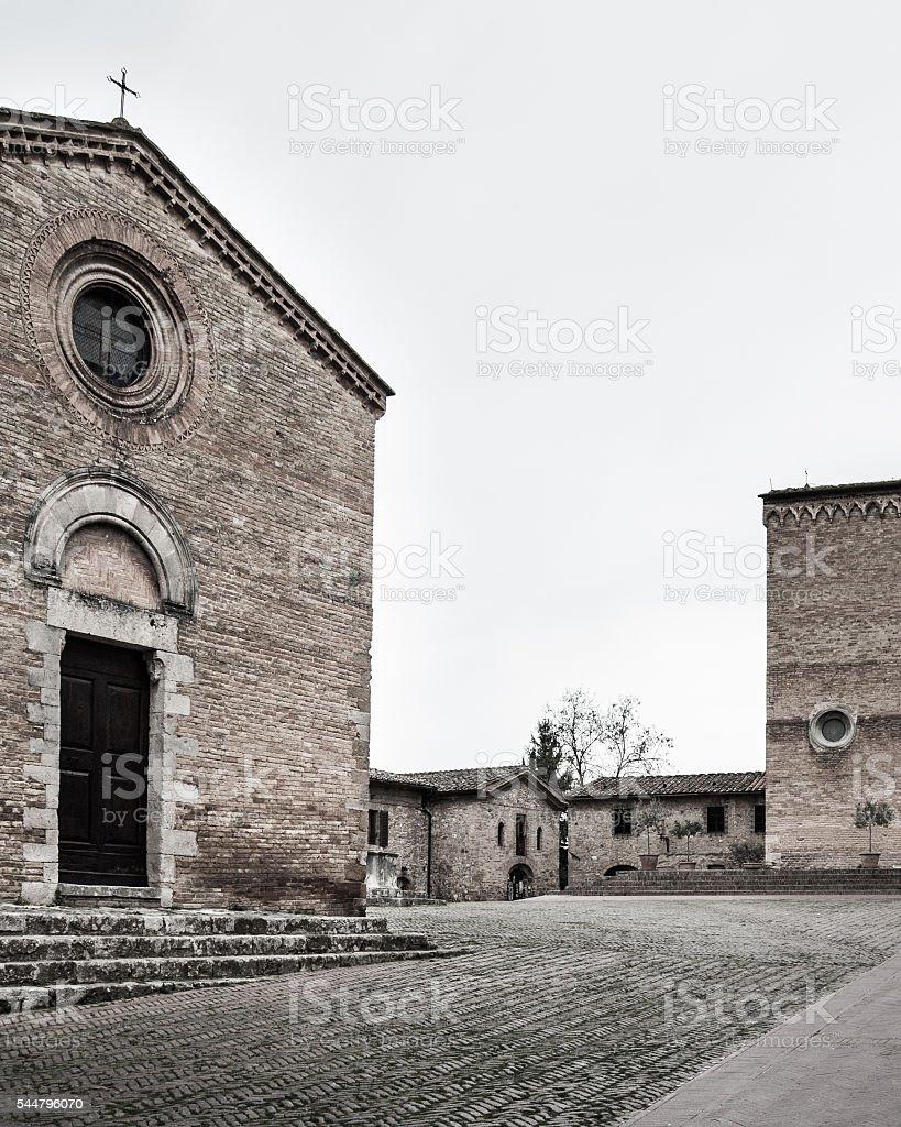 Santi Giusti e Clemente church in San Gimignano stock photo