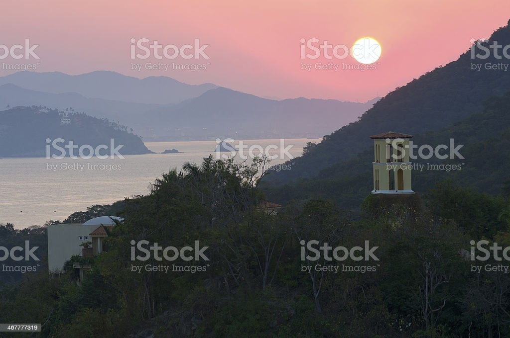 Santiago Bay Sunrise and Mountains in Manzanillo stock photo