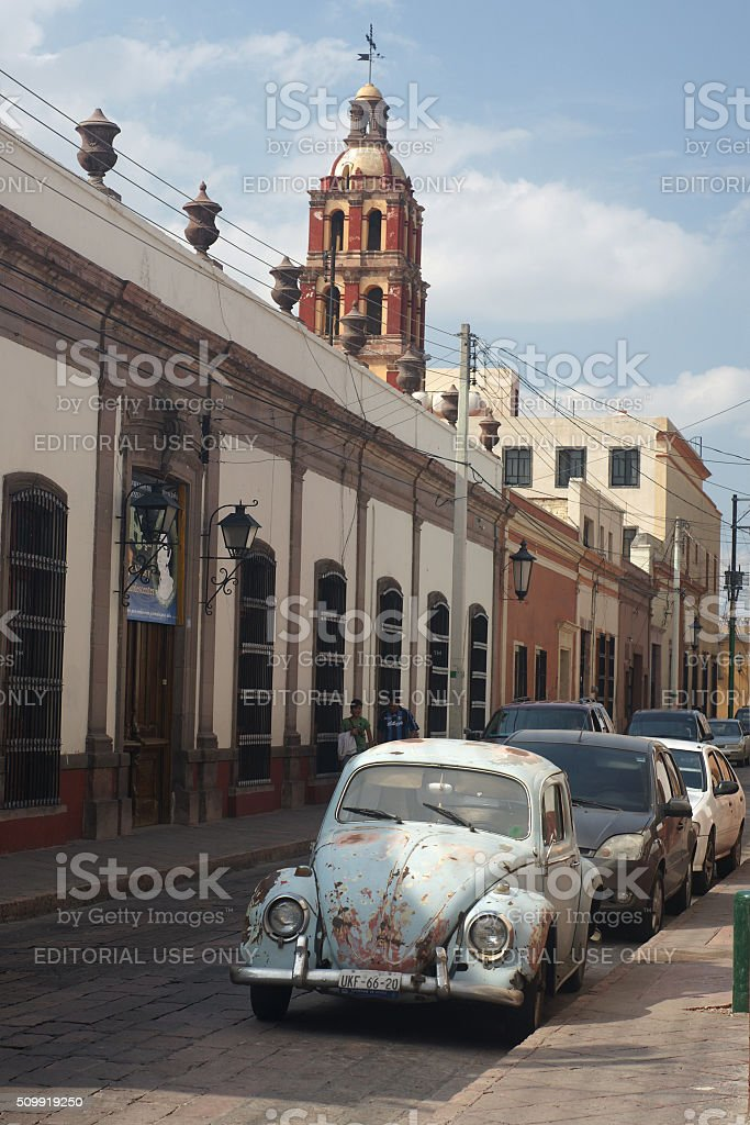 Santiago de Queretaro street view with beetle, Mexico stock photo