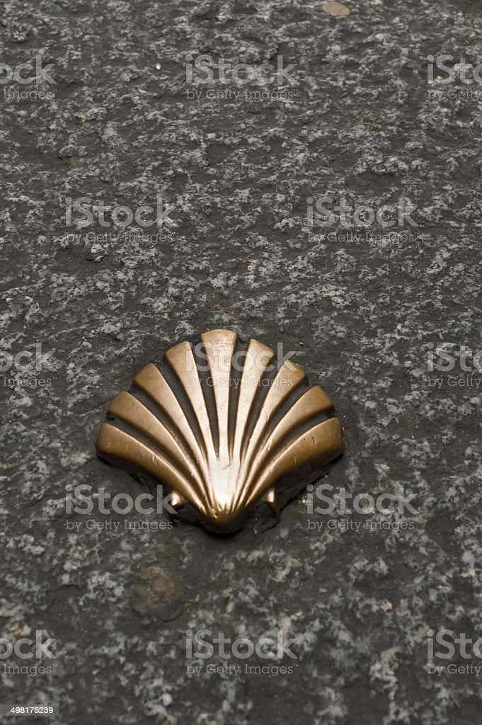 Santiago Route Pilmgrim Shell on the road stock photo