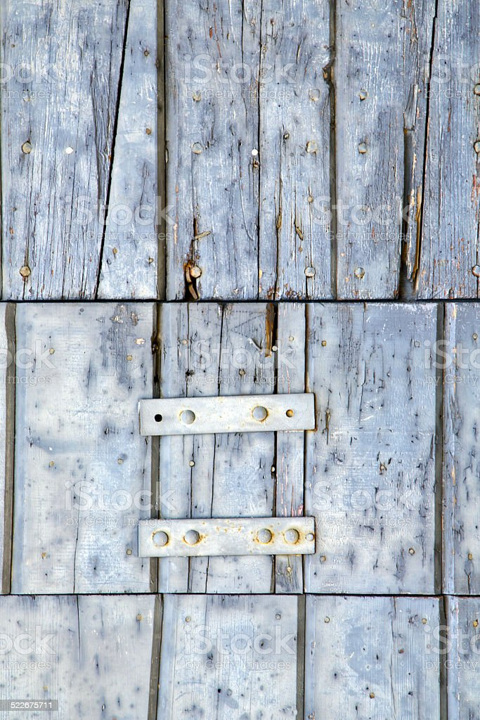 santo antonino abstract   in a  door curch  closed wood lombardy stock photo