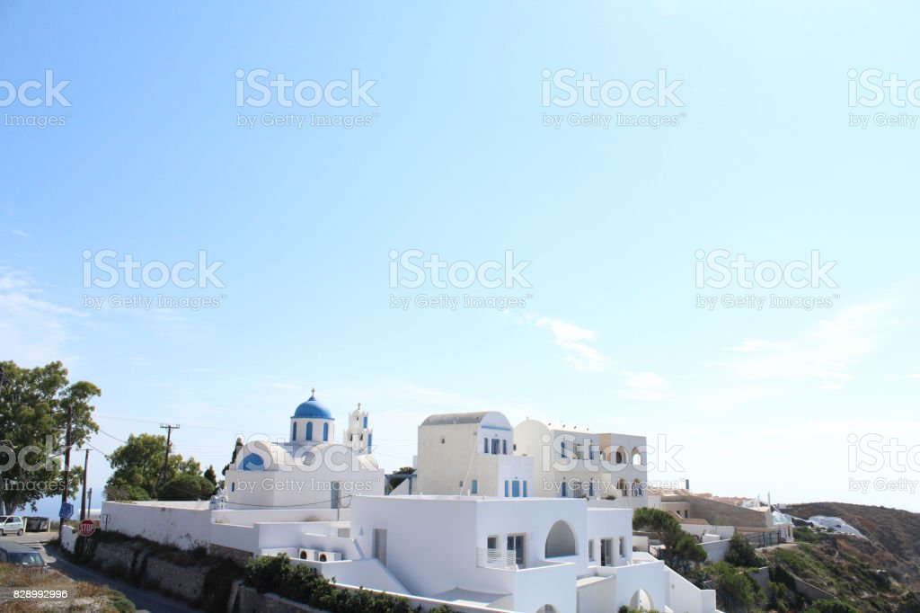 Santorini Achitecture Buildings on a Cliff Side of a Mountain stock photo