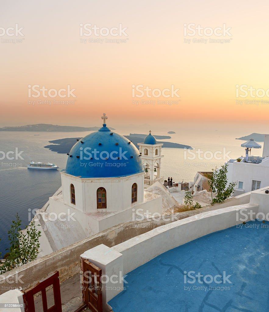 Santorini bell tower and blue domes in Oia on Greece stock photo